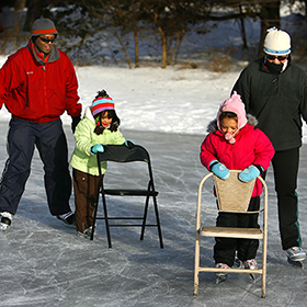 people skating on a finished ice rink