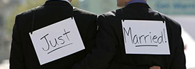 "couple with ""just married"" signs on their backs"
