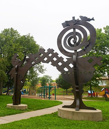 Sculpture in Armatage Park features a seahorse, birds and a large swirl.