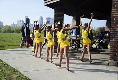 Dancers at picnic shelters