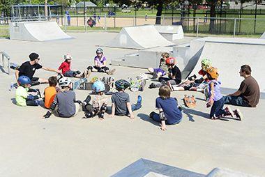 group in skate park bowl