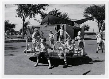 Children on Merry-Go-Round at Bohanon Field, 1958