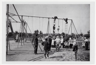 Children on playground structure in North Commons Park, 1905-1915