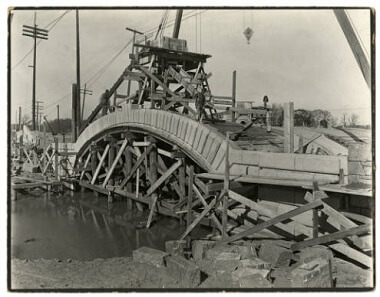 Constructing the bridge over the lagoon between Bde Maka Ska and Lake of the Isles, 1911