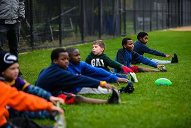 Youth football team stretching