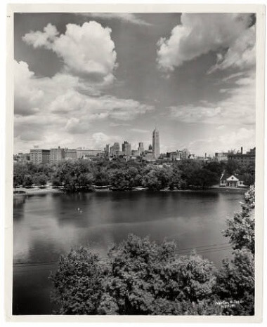 Loring Park Lake and shelter building with city skyline in the background, 1958-1958