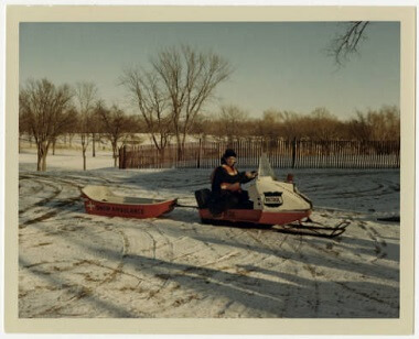 Park Patrol officer on snowmobile at Meadowbrook Golf Course, 1967