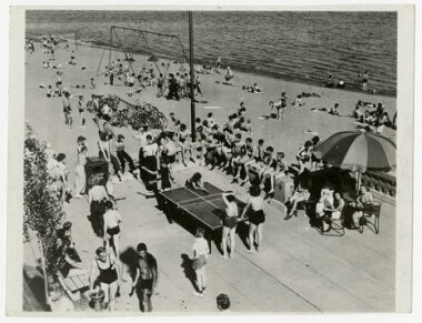 Table tennis and playground on the beach at Bde Maka Ska, 1940s