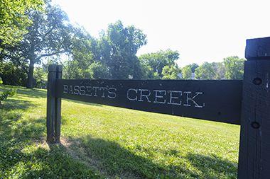 Bassett's Creek Park sign