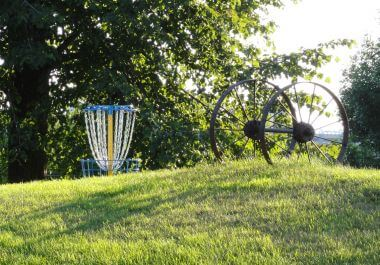 Disc Golf with Wagon Wheel Sculpture