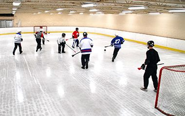People playing hockey.