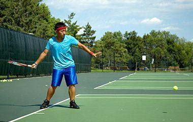 Man playing tennis at Webber Park