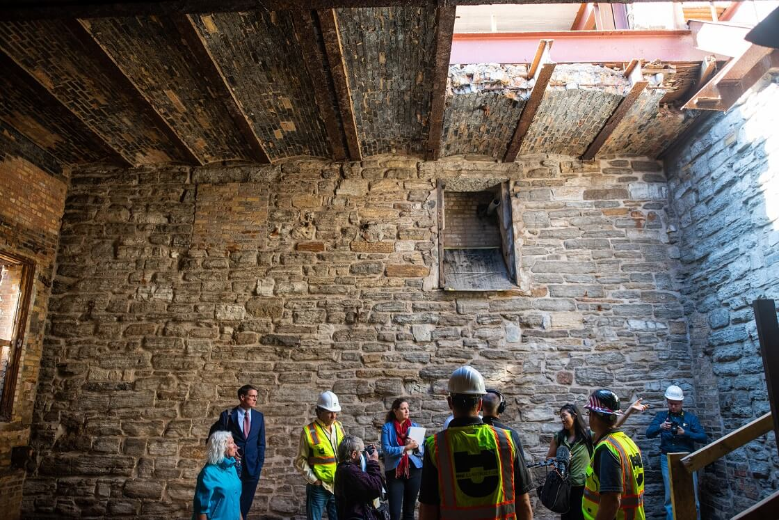 Minneapolis park officials and local media take a tour of the mill ruins that will be incorporated into the Water Works Park Pavilion