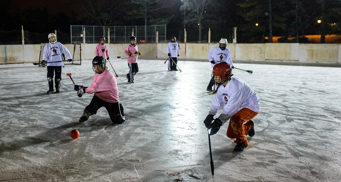 Women's broomball at night at McRae Park