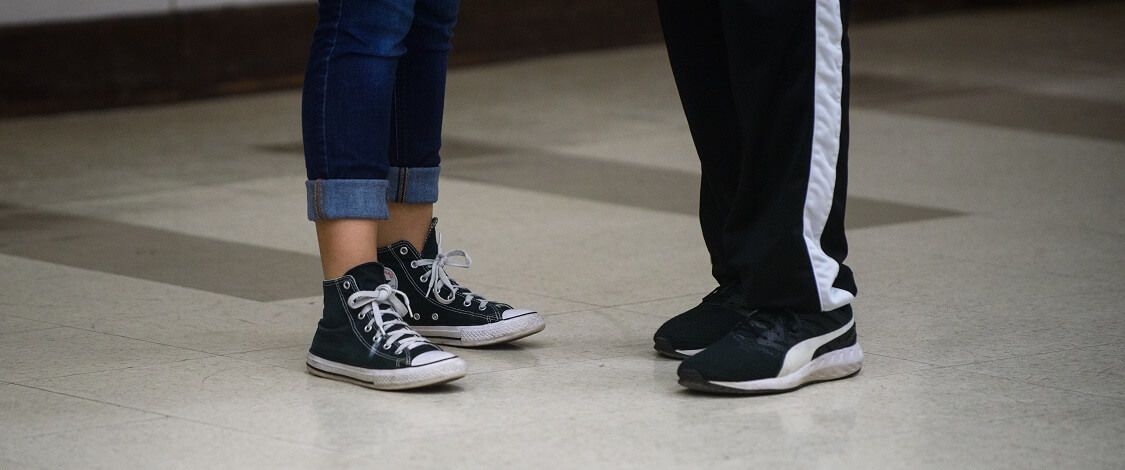Two pairs of feet at a dance class