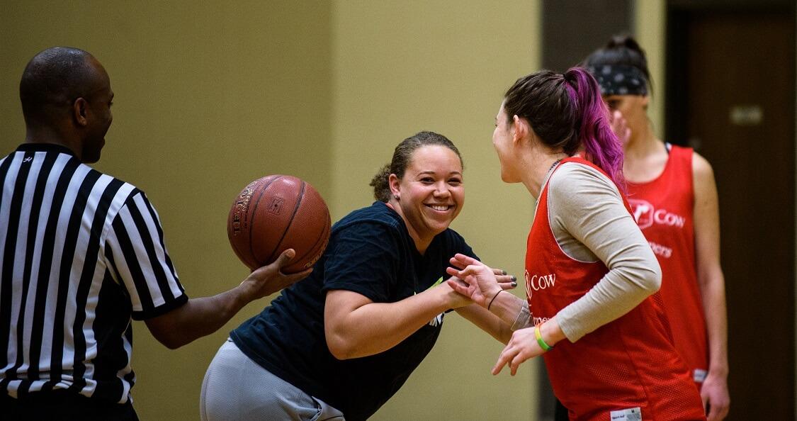 Tip-off for a women's basketball game at Lynnhurst Recreation Center