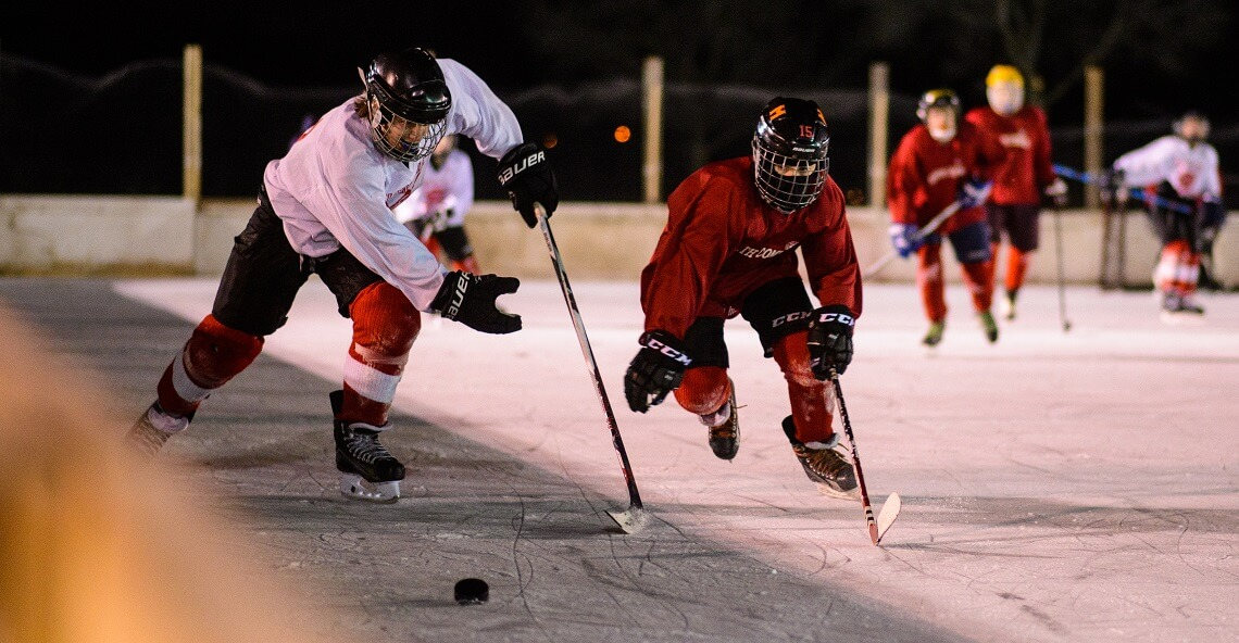 Outdoor youth hockey game at Pearl Park