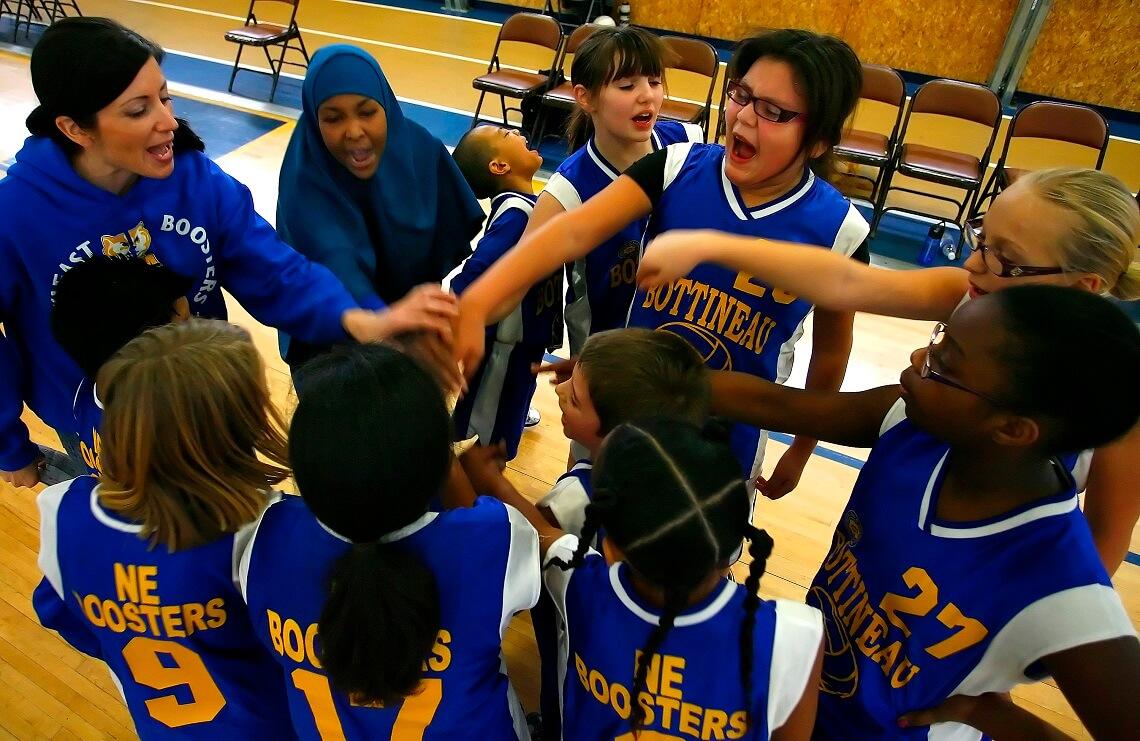 Youth sports huddle at Bottineau Recreation Center