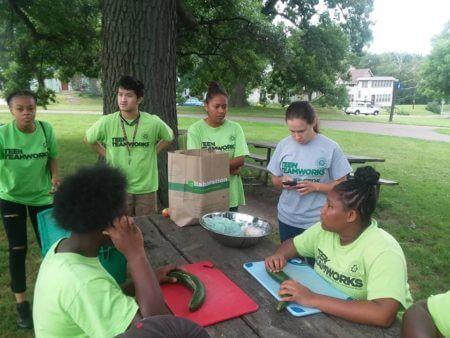 Teen Teamworks members preparing food.