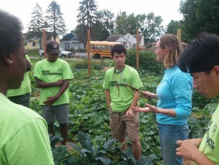 Teen Teamworks members gardening.